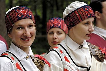 Folk dancers in traditional costume, Open Air Ethnographic Museum (Latvijas etnografiskais brivdabas muzejs), near Riga, Latvia, Baltic States, Europe