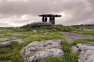 Moody sky over Poulnabrone Dolmen Portal Megalithic tomb at dusk, The Burren, County Clare, Munster, Republic of Ireland (Eire), Europe