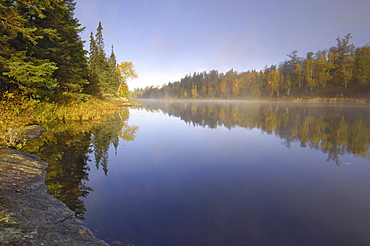 Misty morning on Hoe Lake, Boundary Waters Canoe Area Wilderness, Superior National Forest, Minnesota, United States of America, North America