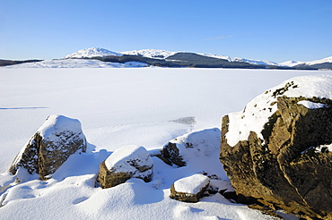 Clatteringshaws Loch, frozen and covered in winter snow, Dumfries and Galloway, Scotland, United Kingdom, Europe