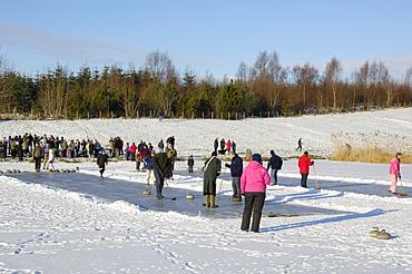 Curling on frozen Bush Loch, Gatehouse of Fleet, Dumfries and Galloway, Scotland, United Kingdom, Europe