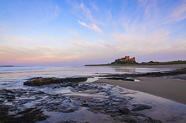 Bamburgh Castle at dusk, Northumberland, England, United Kingdom, Europe