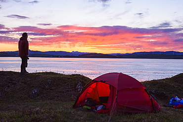 Wild camping, sunrise over the Inner Hebrides, from Scarba looking towards the Sound of Luing, Scotland, United Kingdom, Europe