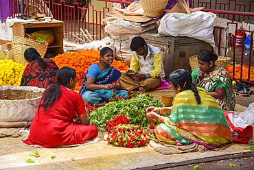 Women working at flower stall at K. R. Market in Banaglore, Karnataka, India, Asia