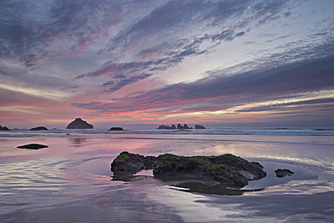 Red clouds, sea stacks, and rocks at sunset, Bandon Beach, Oregon, United States of America, North America