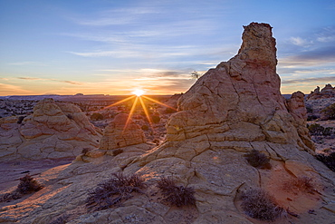 Sandstone formations at first light with a sunburst, Coyote Buttes Wilderness, Vermilion Cliffs National Monument, Arizona, United States of America, North America