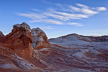 Clouds over white and salmon sandstone, White Pocket, Vermilion Cliffs National Monument, Arizona, United States of America, North America