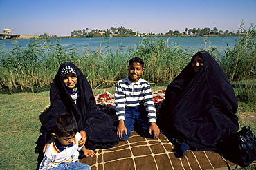 Family group beside the Tigris River, Iraq, Middle East