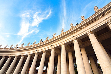 Bernini's 17th century colonnade and statues of saints, St. Peter's Square, Vatican City, UNESCO World Heritage Site, Rome, Lazio, Italy, Europe