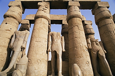 Colonnade and Osiris statues, Luxor Temple, Thebes, UNESCO World Heritage Site, Egypt, North Africa, Africa