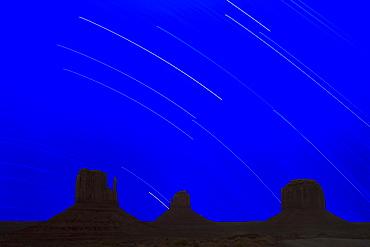 Long explosure resulting in star stripes in sky, Monument Valley Navajo Tribal Park, Arizona Utah border, United States of America, North America