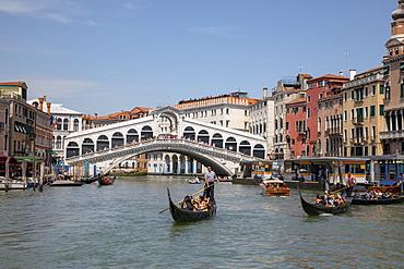 Gondolas by Rialto Bridge in Venice, Italy, Europe