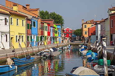 Colorful buildings on canal in Burano, Italy, Europe