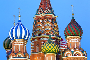 Onion domes of St. Basil's Cathedral in Red Square illuminated in the evening, UNESCO World Heritage Site, Moscow, Russia, Europe