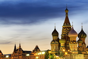 The onion domes of St. Basil's Cathedral and Gum department store in Red Square illuminated at night, UNESCO World Heritage Site, Moscow, Russia, Europe