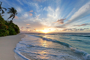 Sunrise over the Indian Ocean from a deserted beach in the Northern Huvadhu Atoll, Maldives, Indian Ocean, Asia
