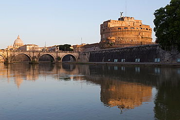 The River Tiber with Castel Sant' Angelo, Ponte Sant' Angelo bridge and the dome of St. Peter's Basilica, Rome, Lazio, Italy, Europe