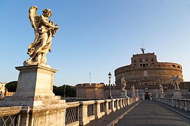 Angel statues on Ponte Sant' Angelo bridge with Castel Sant' Angelo, Rome, Lazio, Italy, Europe