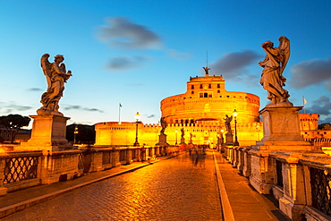 Angel statues on Ponte Sant' Angelo bridge with Castel Sant' Angelo at dusk, Rome, Lazio, Italy, Europe