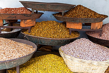 Dishes of spices for sale in a street market in the city of Udaipur, Rajasthan, India, Asia