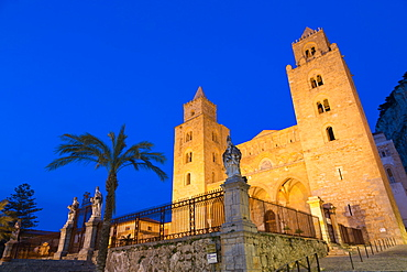 The facade of the Norman Cathedral of Cefalu illuminated at night, Sicily, Italy, Europe