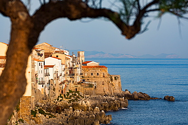 Historic houses on the rocky coastline of Cefalu, Sicily, Italy, Mediterranean, Europe