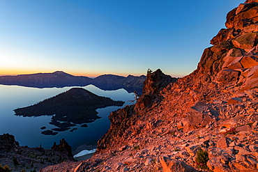 Wizard Island and the still waters of Crater Lake at dawn, the deepest lake in the U.S.A., part of the Cascade Range, Oregon, United States of America, North America