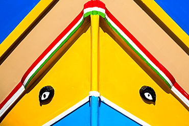 Detail of traditional brightly painted fishing boat in the harbour at Marsaxlokk, Malta, Mediterranean, Europe