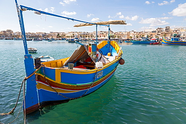 Traditional brightly painted fishing boat in the harbour at Marsaxlokk, Malta, Mediterranean, Europe