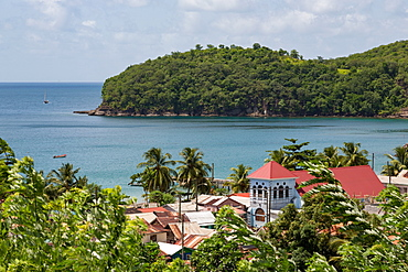 Church in the small town of Canaries, with Canaries Bay beyond, St. Lucia, Windward Islands, West Indies Caribbean, Central America