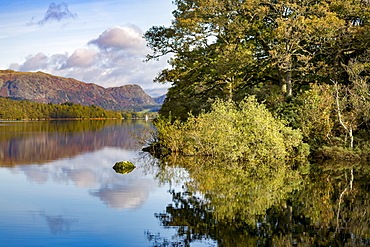 Shoreline, mountains and sky with a perfect reflection in the still waters of Coniston Water, Lake District National Park, UNESCO World Heritage Site, Cumbria, England, United Kingdom, Europe