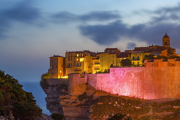 Night view of the Citadel and old town of Bonifacio perched on rugged cliffs, Bonifacio, Corsica, France, Mediterranean, Europe