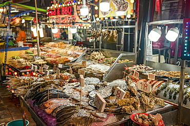 Fresh seafood for sale in Bukit Bintang food street at night in the capital city of Kuala Lumpur, Malaysia, Southeast Asia, Asia