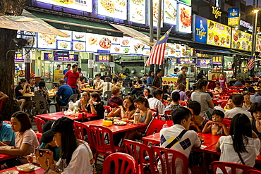 People enjoying a meal in Bukit Bintang food street at night in the capital city of Kuala Lumpur, Malaysia, Southeast Asia, Asia