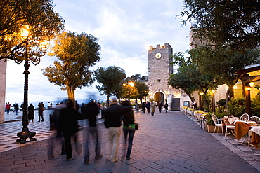 People strolling in Piazza IX Aprile in the evening, Torre dell Orologio, Taormina, Sicily, Italy, Europe
