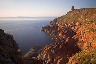 WWII German Observation tower and the rocky northwest coastline of Jersey, Channel Islands, United Kingdom, Europe