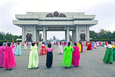 Women in colourful traditional dresses at mass dancing, Pyongyang, Democratic People's Republic of Korea (DPRK), North Korea, Asia