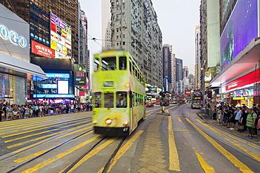 Pedestrians and traffic at a busy road crossing in Causeway Bay, Hong Kong Island, Hong Kong, China, Asia