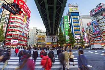 Neon signs cover buildings in the consumer electronics district of Akihabara, Tokyo, Japan, Asia