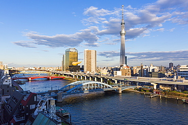 City skyline and Skytree on the Sumida River, Tokyo, Japan, Asia