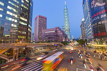 Traffic in front of Taipei 101 at a busy downtown intersection in the Xinyi district, Taipei, Taiwan, Asia