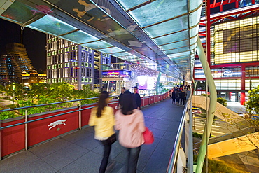 Xinyi downtown district, pedestrian bridge in the prime shopping and financial district, Taipei, Taiwan, Asia