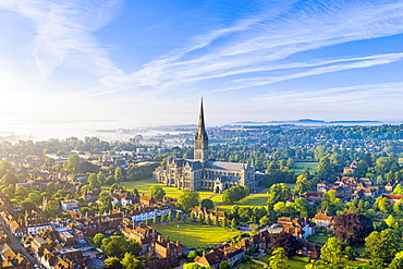 Aerial view over Salisbury and Salisbury Cathedral on a misty summer morning, Salisbury, Wiltshire, England, United Kingdom, Europe