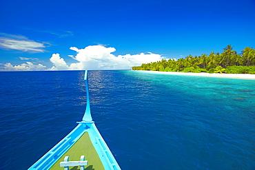 Maldivian fishing boat (dhoni) and tropical island, Maldives, Indian Ocean, Asia
