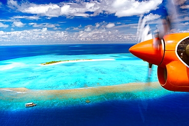 Aerial view of island and seaplane, Male Atoll, The Maldives, Indian Ocean, Asia