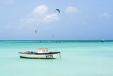 Fishing boat and windsurfing kitesurfing on Hadicurari Beach, Aruba, ABC Islands, Dutch Antilles, Caribbean, Central America