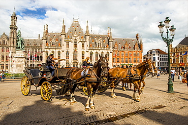Horse drawn carriage in The Markt (Market Square), Bruges, UNESCO World Heritage Site, West Flanders, Belgium, Europe