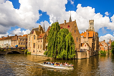 Tour boat on Rozenhoedkaai canal with Belfort tower, Bruges, UNESCO World Heritage Site, West Flanders, Belgium, Europe