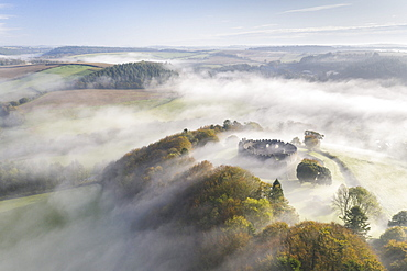 Aerial view by drone of autumn mist swirling above Restormel Castle in Cornwall, United Kingdom, Europe