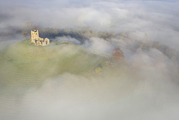 Aerial image of St Michael's Church on Burrow Mump, surrounded by a blanket of mist, Burrowbridge, Somerset, England, United Kingdom, Europe